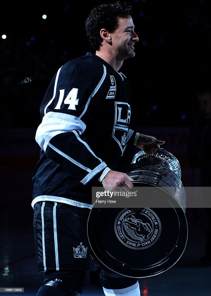 Justin Williams #14 of the Los Angeles Kings reacts as he carries the Stanley Cup during a ceremony before the NHL season opening game against the Chicago Blackhawks at Staples Center on January 19, 2013 in Los Angeles, California.