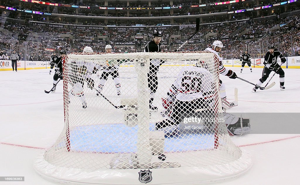 Justin Williams #14 of the Los Angeles Kings scores against goaltender <a gi-track='captionPersonalityLinkClicked' href=/galleries/search?phrase=Corey+Crawford&family=editorial&specificpeople=818935 ng-click='$event.stopPropagation()'>Corey Crawford</a> #50 of the Chicago Blackhawks in the first period of Game Three of the Western Conference Final during the 2013 NHL Stanley Cup Playoffs at Staples Center on June 4, 2013 in Los Angeles, California.