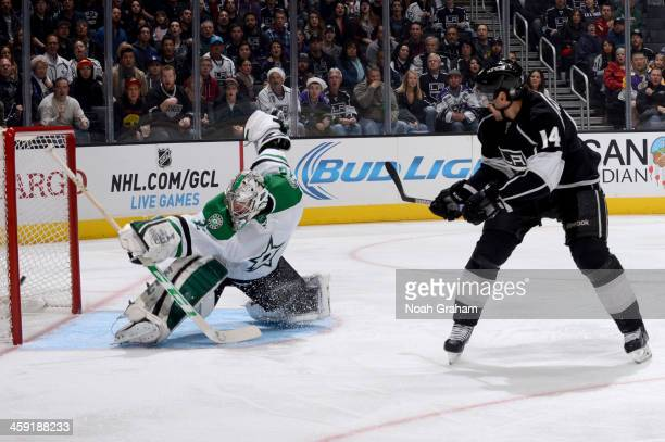 Justin Williams of the Los Angeles Kings shoots and scores a goal against Kari Lehtonen of the Dallas Stars at Staples Center on December 23 2013 in...