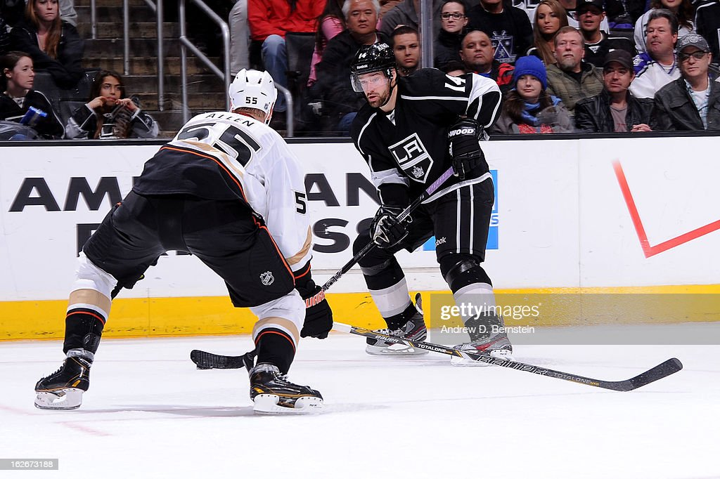 Justin Williams #14 of the Los Angeles Kings skates with the puck against Bryan Allen #55 of the Anaheim Ducks at Staples Center on February 25, 2013 in Los Angeles, California.