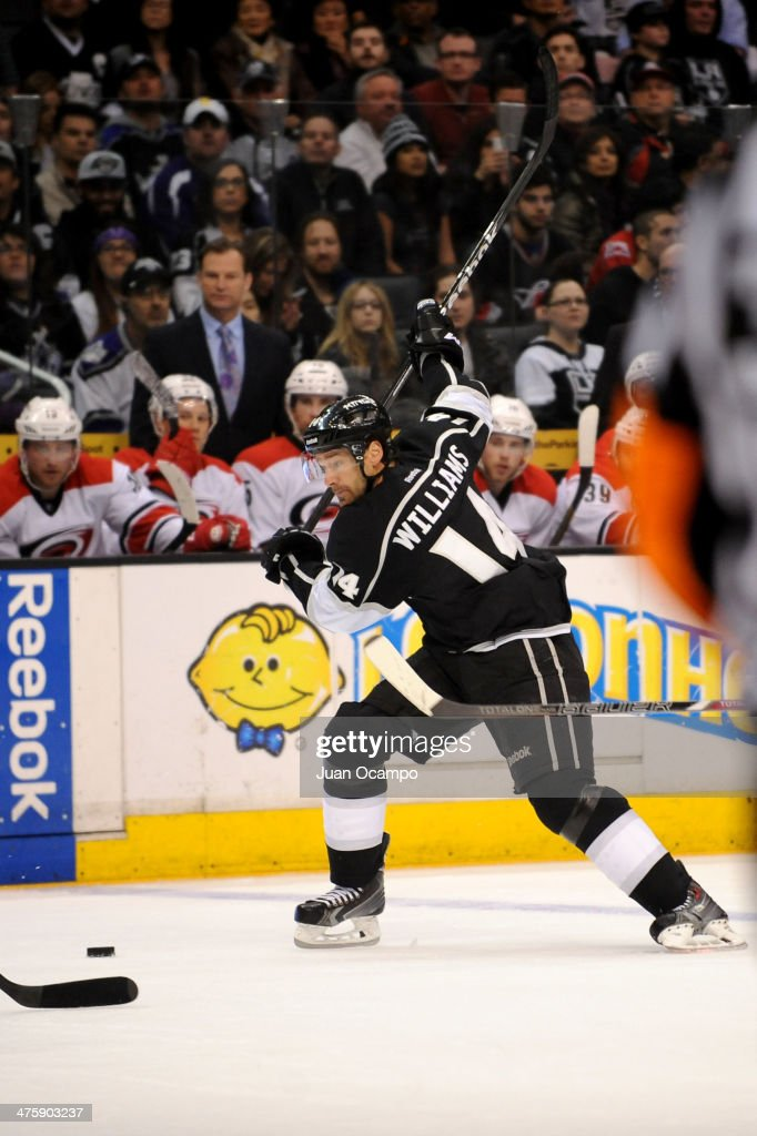 Justin Williams #14 of the Los Angeles Kings skates with the puck against the Carolina Hurricanes at Staples Center on March 1, 2014 in Los Angeles, California.