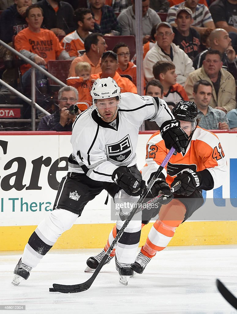 Justin Williams #14 of the Los Angeles Kings skates with the puck as Jason Akeson #42 of the Philadelphia Flyers defends during their game at the Wells Fargo Center on October 28, 2014 in Philadelphia, Pennsylvania.