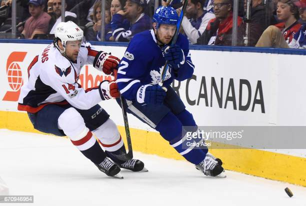 Justin Williams of the Washington Capitals and Matt Hunwick of the Toronto Maple Leafs chase the puck during the second period in Game Four of the...