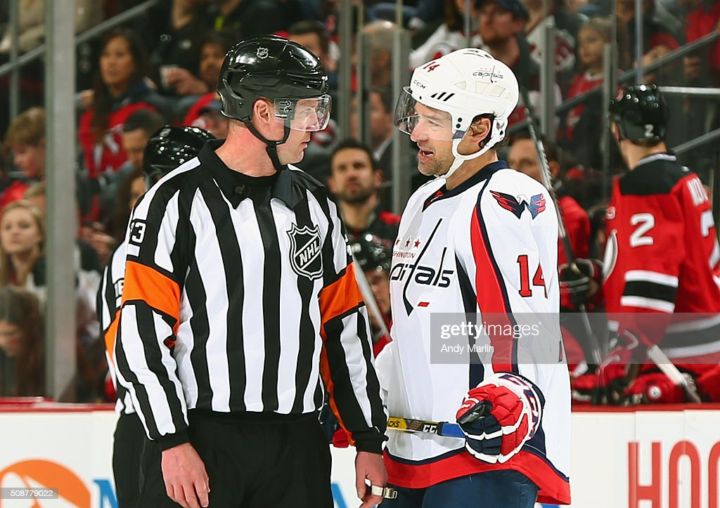 <a gi-track='captionPersonalityLinkClicked' href=/galleries/search?phrase=Justin+Williams&family=editorial&specificpeople=201745 ng-click='$event.stopPropagation()'>Justin Williams</a> #14 of the Washington Capitals and referee <a gi-track='captionPersonalityLinkClicked' href=/galleries/search?phrase=Kevin+Pollock+-+Arbitro+di+hockey+su+ghiaccio&family=editorial&specificpeople=4596554 ng-click='$event.stopPropagation()'>Kevin Pollock</a> #33 talk during a timeout against the New Jersey Devils during the game at the Prudential Center on February 6, 2016 in Newark, New Jersey.