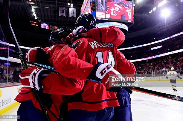 Justin Williams of the Washington Capitals celebrates his first goal of the game with his teammates in the first period during a NHL game against the...
