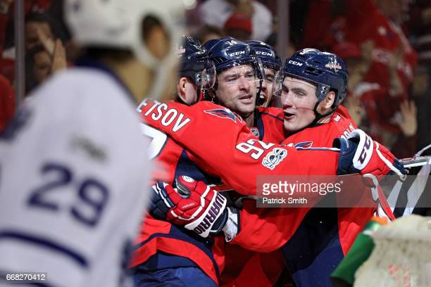 Justin Williams of the Washington Capitals celebrates his second goal of the game with teammates against the Toronto Maple Leafs in the second period...