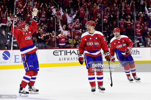 Justin Williams of the Washington Capitals celebrates with his teammates after scoring a hat trick in the third period during a game against the New...