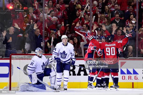 Justin Williams of the Washington Capitals celebrates with his teammates after scoring a goal in the second period against the Toronto Maple Leafs in...