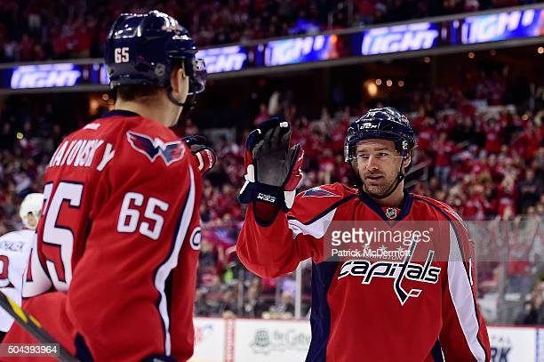 Justin Williams of the Washington Capitals celebrates with his teammate Andre Burakovsky after scoring a goal against the Ottawa Senators in the...