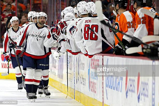 Justin Williams of the Washington Capitals celebrates with teammates after scoring a second period goal against the Philadelphia Flyers at Wells...