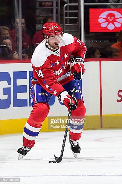 Justin Williams of the Washington Capitals controls the puck against the Ottawa Senators in the first period during an NHL game at Verizon Center on...