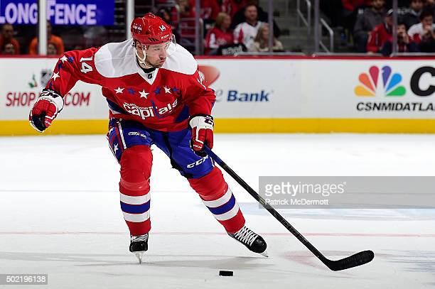 Justin Williams of the Washington Capitals controls the puck against the Ottawa Senators in the third period during an NHL game at Verizon Center on...