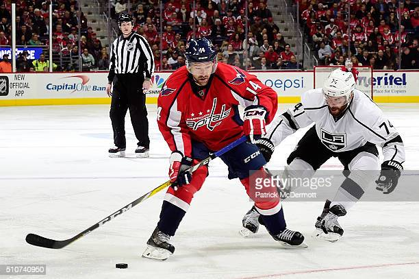 Justin Williams of the Washington Capitals controls the puck against Dwight King of the Los Angeles Kings in the third period during their game at...