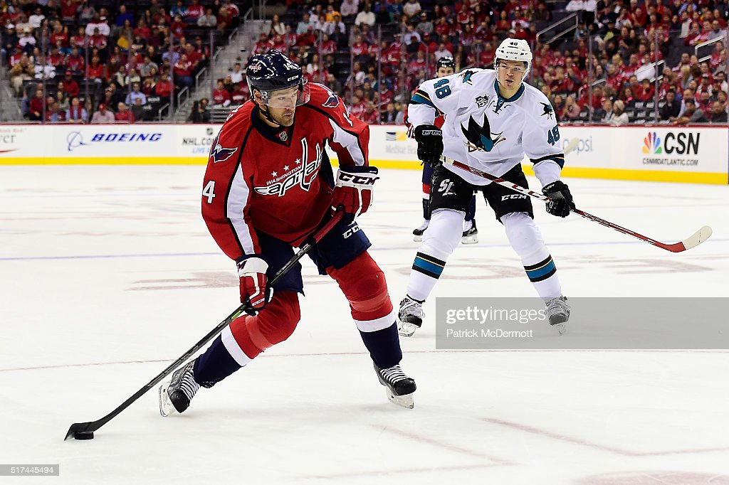 Justin Williams #14 of the Washington Capitals controls the puck in the first period during an NHL game against the San Jose Sharks at Verizon Center on October 13, 2015 in Washington, DC.