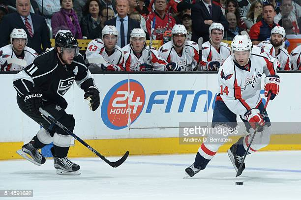Justin Williams of the Washington Capitals handles the puck against Anze Kopitar of the Los Angeles Kings at STAPLES Center on March 09 2016 in Los...