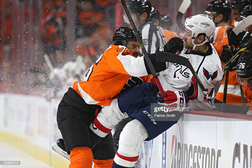 <a gi-track='captionPersonalityLinkClicked' href=/galleries/search?phrase=Justin+Williams+-+Ice+Hockey+Player&family=editorial&specificpeople=201745 ng-click='$event.stopPropagation()'>Justin Williams</a> #14 of the Washington Capitals is checked by <a gi-track='captionPersonalityLinkClicked' href=/galleries/search?phrase=Colin+McDonald+-+Ice+Hockey+Player&family=editorial&specificpeople=10833458 ng-click='$event.stopPropagation()'>Colin McDonald</a> #36 of the Philadelphia Flyers during the second period in Game Six of the Eastern Conference Quarterfinals during the 2016 NHL Stanley Cup Playoffs at Wells Fargo Center on April 24, 2016 in Philadelphia, Pennsylvania.