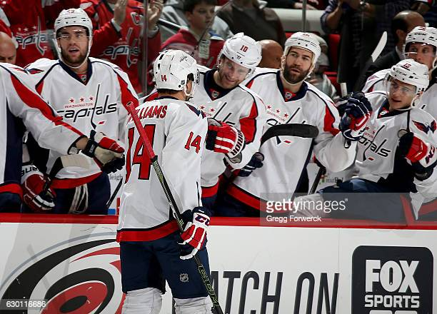 Justin Williams of the Washington Capitals is congratulated by teammates after scoring during an NHL game against the Carolina Hurricanes on December...