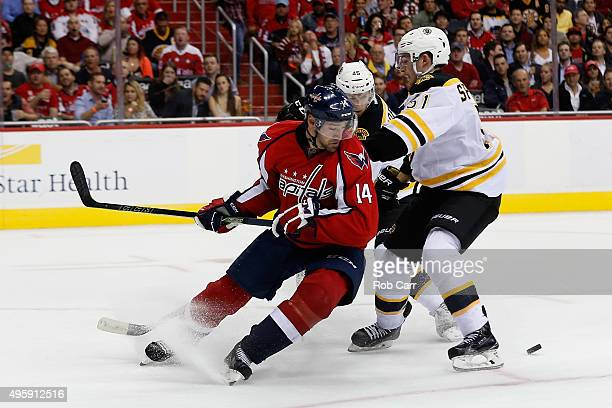 Justin Williams of the Washington Capitals looks for the puck against Ryan Spooner of the Boston Bruins at Verizon Center on November 5 2015 in...