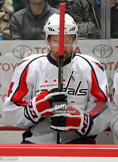 Justin Williams of the Washington Capitals looks on from the bench prior to puck drop against the Winnipeg Jets at the MTS Centre on December 5 2015...