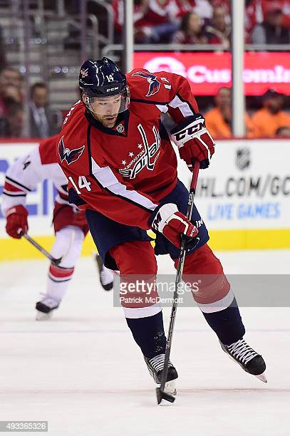 Justin Williams of the Washington Capitals moves the puck up ice in the first period against the Carolina Hurricanes during an NHL game at Verizon...
