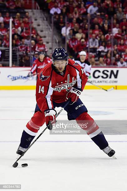 Justin Williams of the Washington Capitals moves the puck up ice against the New Jersey Devils in the first period during the Capitals NHL season...