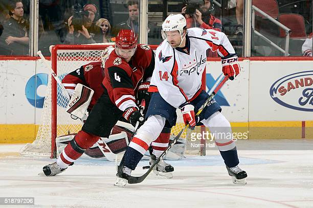 Justin Williams of the Washington Capitals settles the puck as Zbynek Michalek of the Arizona Coyotes defends during the second period at Gila River...