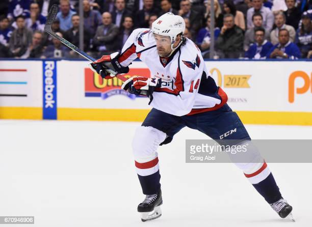 Justin Williams of the Washington Capitals skates against the Toronto Maple Leafs during the second period in Game Four of the Eastern Conference...