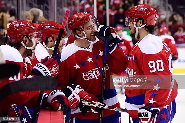 Justin Williams of the Washington Capitals talks with his teammate Marcus Johansson after scoring a hat trick in the third period during a game...