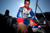 Justin Wilson of England driver of the Dale Coyne Racing Honda prepares for qualifying for the Milwaukee IndyFest at the Milwaukee Mile on June 14...