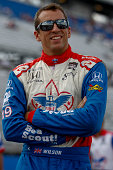Justin Wilson of England driver of the Dale Coyne Racing Honda stands on the grid during qualifying for the ABC Supply Wisconsin 250 at The Milwaukee...
