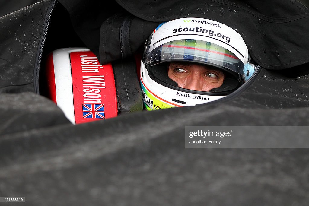 Justin Wilson of England, driver of the #19 Dale Coyne Racing Honda Dallara waits to qualify for the 98th Indianapolis 500 Mile Race on May 17, 2014 at the Indianapolis Motor Speedway in Indianapolis, Indiana.