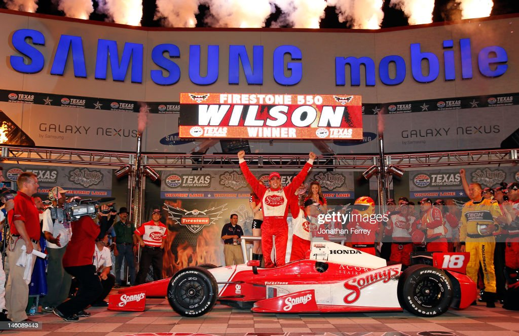 Justin Wilson of England, driver of the #18 Sonny's BBQ Honda Dallara, celebrates in Victory Lane after winning the IZOD IndyCar Series Firestone 550 at Texas Motor Speedway on June 9, 2012 in Fort Worth, Texas.