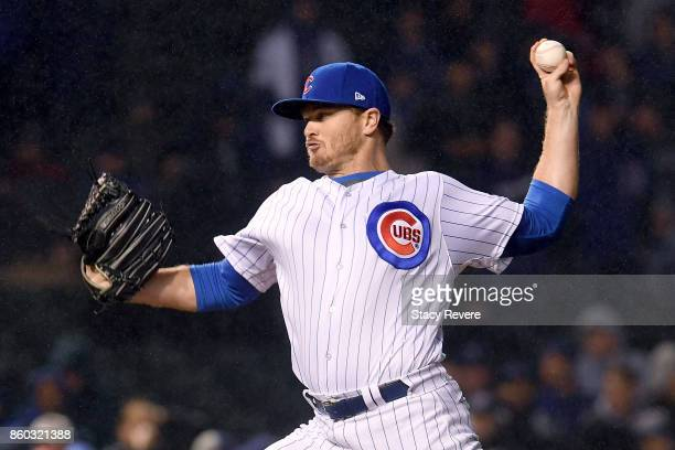 Justin Wilson of the Chicago Cubs pitches in the ninth inning during game four of the National League Division Series against the Washington...