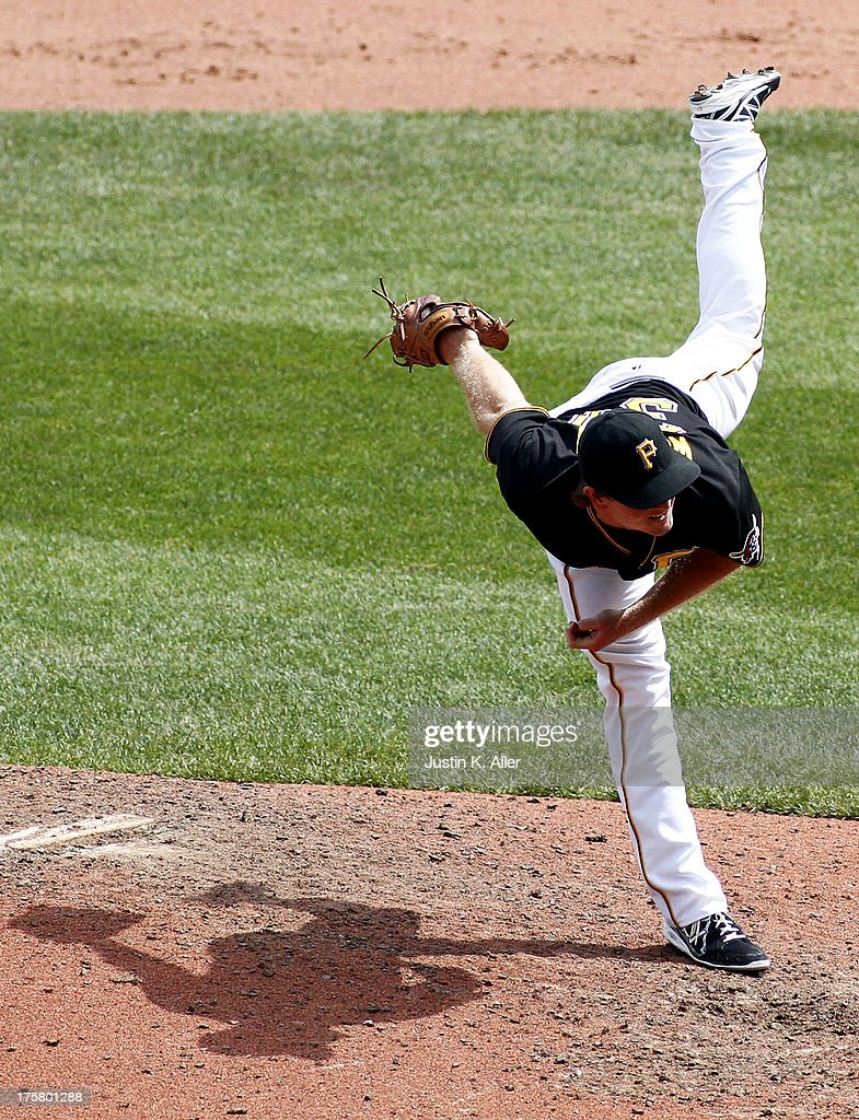 Justin Wilson #37 of the Pittsburgh Pirates pitches in the eighth inning against the Miami Marlins during the game on August 8, 2013 at PNC Park in Pittsburgh, Pennsylvania.