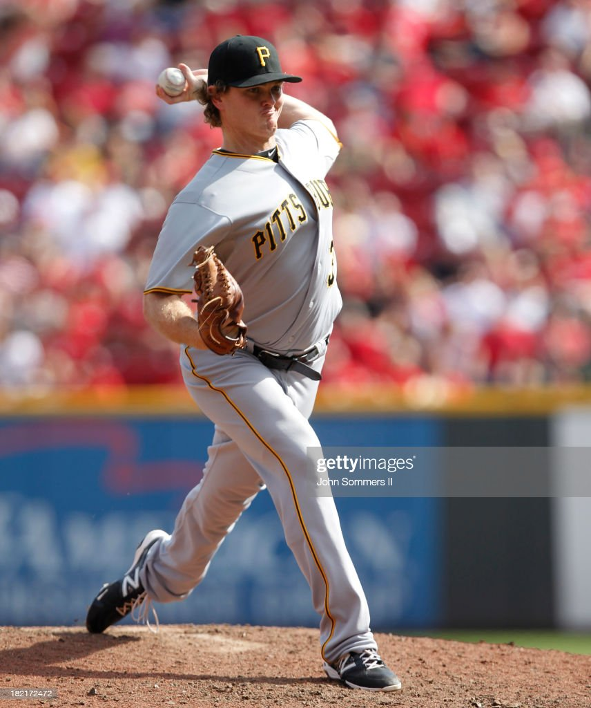 Justin Wilson #37 of the Pittsburgh Pirates throws a pitch during the game against the Cincinnati Reds at Great American Ball Park on September 28, 2013 in Cincinnati, Ohio.