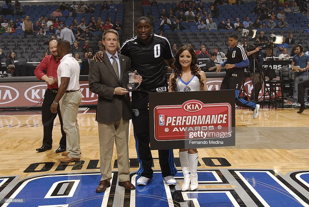 Justin Young, KIA manager, presents Victor Oladipo #5 of the Orlando Magic with the KIA Rookie of the Month award before the game against the Chicago Bulls on January 15, 2014 at Amway Center in Orlando, Florida.