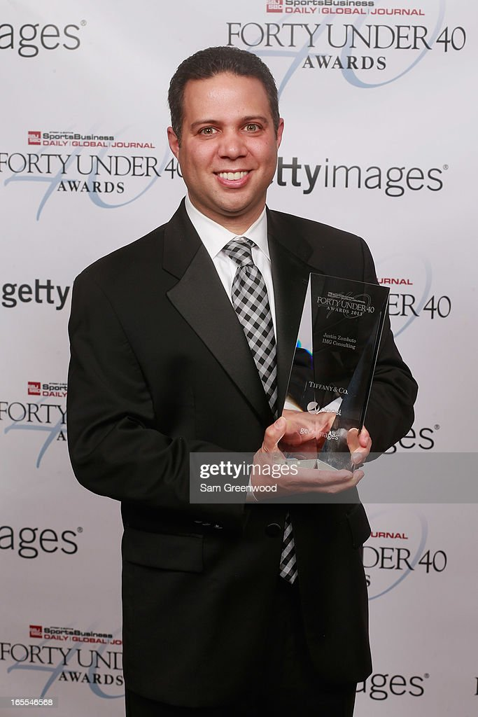 Justin Zambuto of IMG Consulting poses with award at the 2013 Forty Under 40 Awards on April 4, 2013 in Naples, Florida.