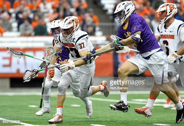 Justin Zelen of the Albany Great Danes checks the stick out of the hands of Ben Williams of the Syracuse Orange during the second quarter at the...