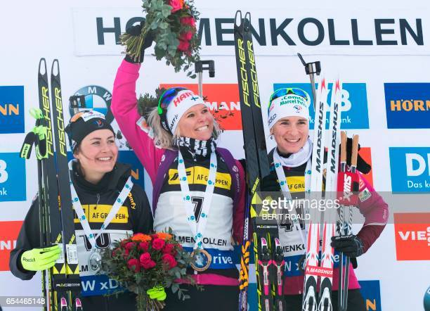 Justine Braisaz from France Mari Laukkanen from Finland and Anais Bescond from France celebrate on the podium after the IBU Biathlon World Cup Women...