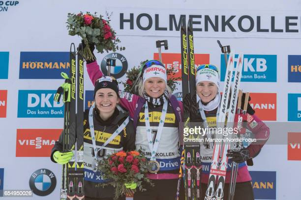 Justine Braisaz of France Mari Laukkanen of Finland and Anais Bescond of France celebrate after the 10 km men's Sprint on March 17 2017 in Oslo Norway