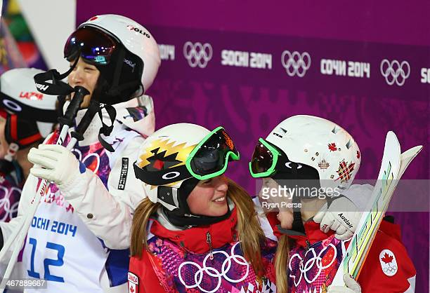 Justine DufourLapointe and Chloe DufourLapointe of Canada celebrate as Aiko Uemura of Japan looks on after the Ladies' Moguls Final during day 1 of...
