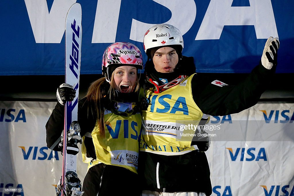 Justine Dufour-Lapointe #1 of Canada and Mikael Kingsbury #1 of Canada pose for photographers after maintaining their yellow bibs during the Dual Moguls competition during the Visa Freestyle International at Deer Valley on February 2, 2013 in Park City, Utah.