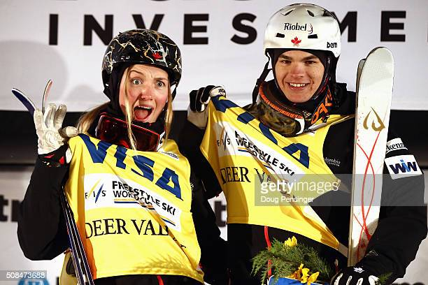 Justine DufourLapointe of Canada and Mikael Kingsbury of Canada take the podium after earning the overall points leaders' jerseys in the FIS...