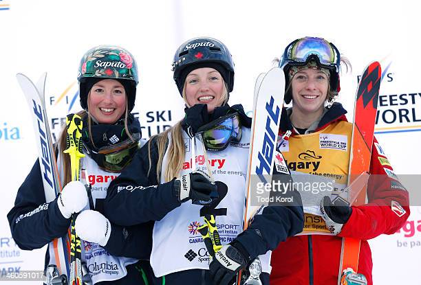 Justine DufourLapointe of Canada celebrates her first place finish with sister Chloe DufourLapointe who finished third and Hannah Kearney of the US...