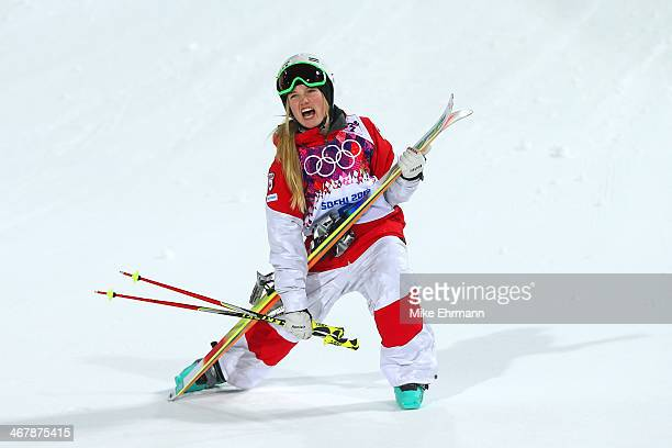 Justine DufourLapointe of Canada celebrates winning gold in the Ladies' Moguls Final 3 on day one of the Sochi 2014 Winter Olympics at Rosa Khutor...