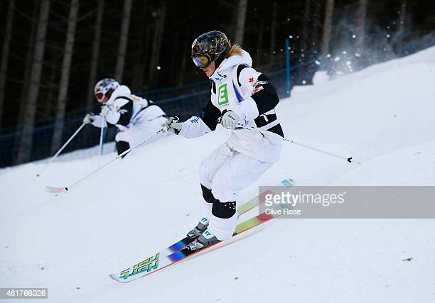 Justine DufourLapointe of Canada competes with Chloe DufourLapointe of Canada during the Women's Dual Moguls Finals of the FIS Freestyle Ski and...