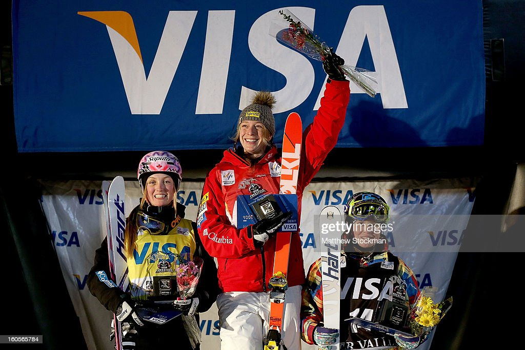 Justine Dufour-Lapointe #1 of Canada in second place, Hannah Kearney #3 in first place and Yulia Galysheva #14 of Kazakhstan in third place pose for photographers on the winners podium after the Ladies Dual Moguls during the Visa Freestyle International at Deer Valley on February 2, 2013 in Park City, Utah.