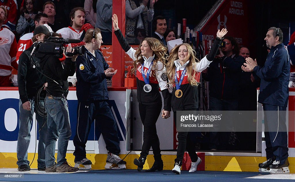 Justine et Chloe Dufour-Lapointe are honored with the singing of O' Canada before the start of the NHL game between the Montreal Canadiens and the Detroit Red Wings during on April 5, 2014 at the Bell Centre in Montreal, Quebec, Canada.