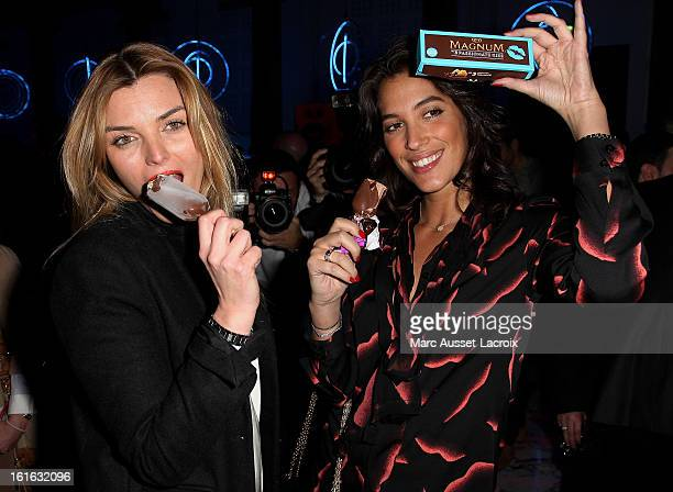 Justine Fraioli and Laurie Cholewa pose during the Magnum Ice Cream party for Valentine's Day at Pavillon Cambon on February 13 2013 in Paris France