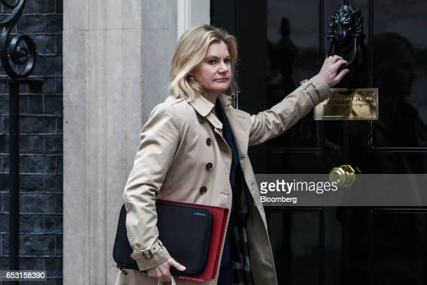 Justine Greening UK education secretary knocks on the door of number 10 as she arrives for a weekly cabinet meeting in Downing Street London UK on...